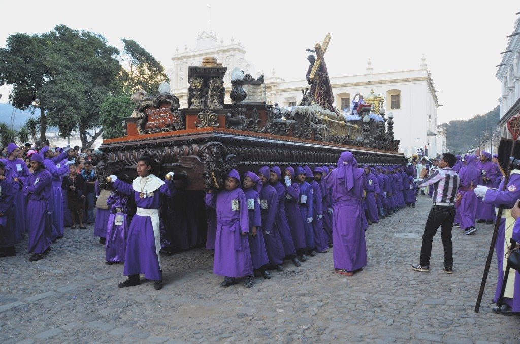 Religious groups carry out religious processions depicting scenes of the Bible.