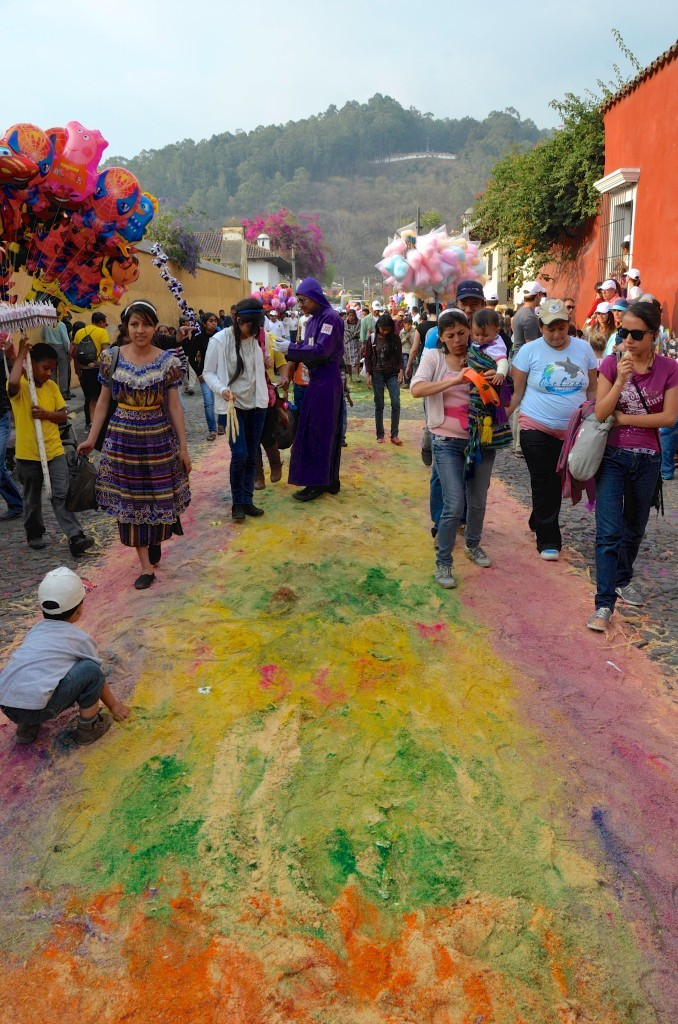 """The processions walk over the """"alfombras"""", leaving carpets of colourful dust on the streets of Antigua."""